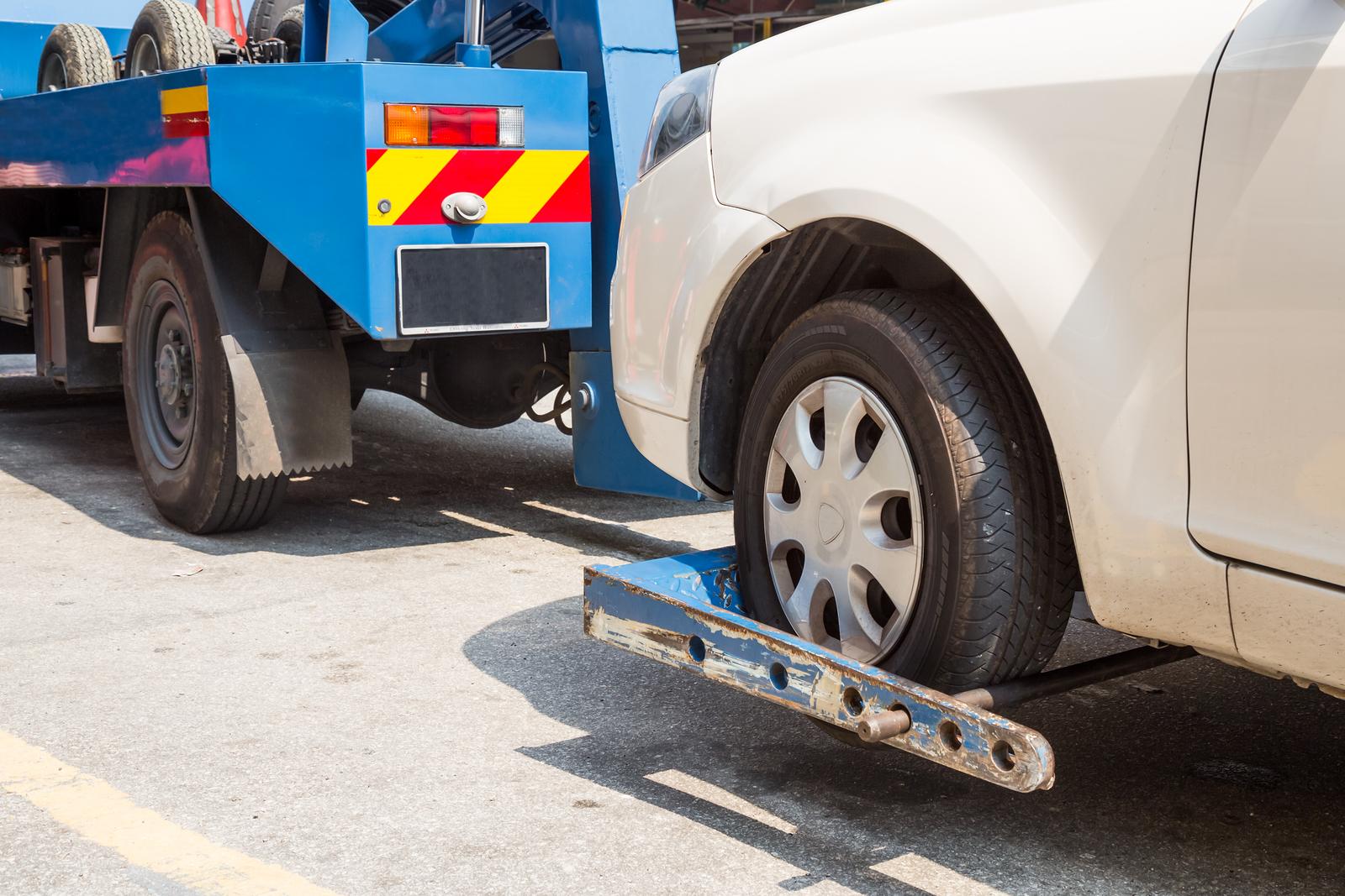 Tow Truck Towing a Broken